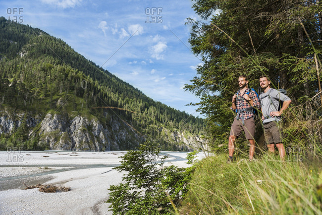 Germany- Bavaria- two young hikers with backpacks looking at view