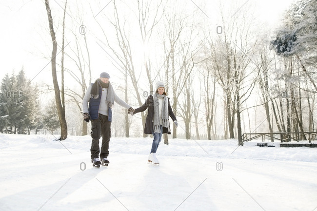 Senior couple ice skating