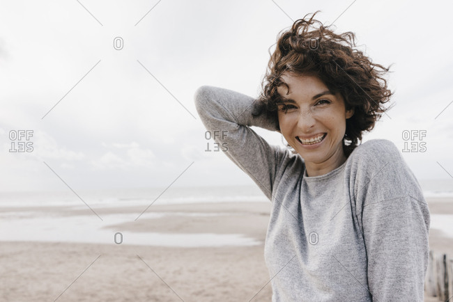 Portrait of happy woman on the beach