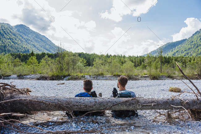 Germany- Bavaria- back view of two hikers having a rest