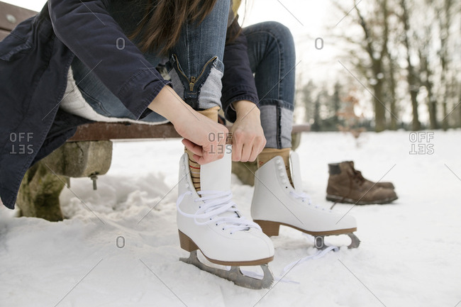 Woman putting on her ice skates