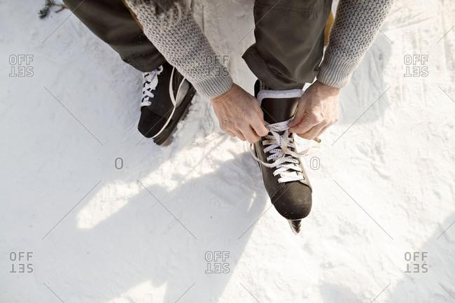 Man putting on ice skates