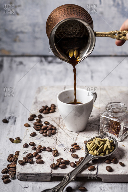Pouring Arabian Coffee into cup