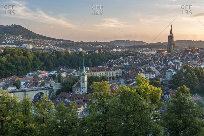 Switzerland- Bern- cityscape with Nydeggkirche and minster in the evening