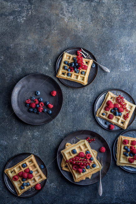 Waffles with fruit on plates