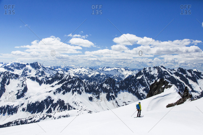 A man skis down a steep slope off Sahale Peak, a remote mountain in the North Cascades National Park, WA