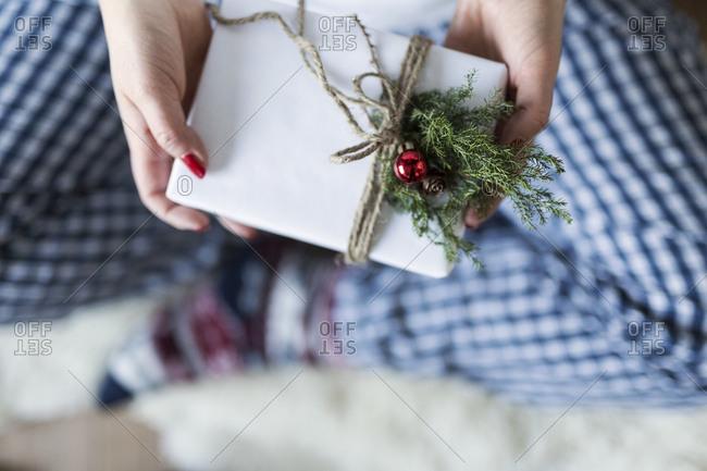 Woman wrapping Christmas gift