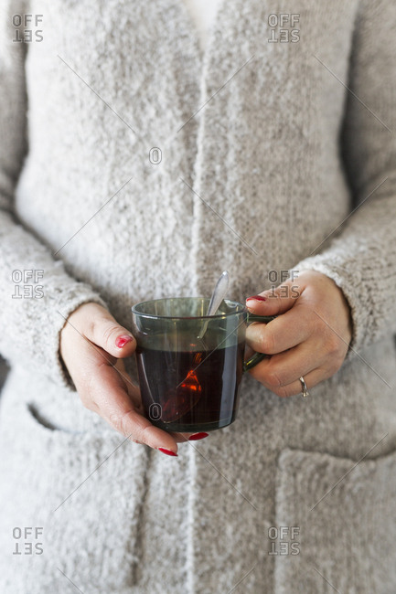 Woman holding cup with mulled wine