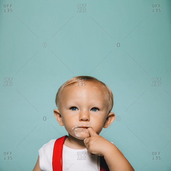 Little boy with his finger in his mouth