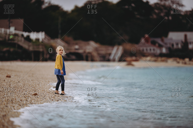 Adorable girl at the waters edge