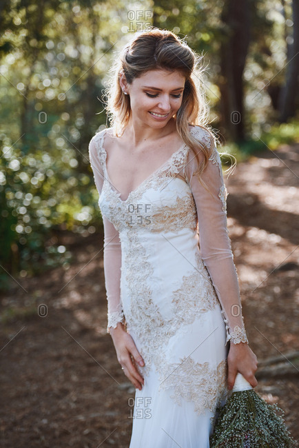 Portrait of happy smiling elegant bride woman in lace wedding gown