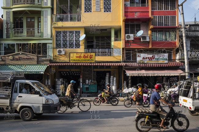 Mandalay, Myanmar - 23 September 2016: Traffic on a street of Mandalay