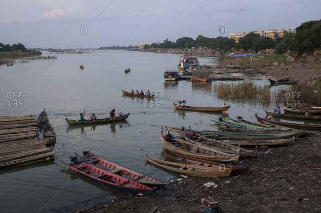 Mandalay, Myanmar - 23 September 2016: Boats on the shore if the Irrawaddy river