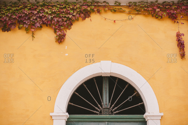 Arched window with iron date marker
