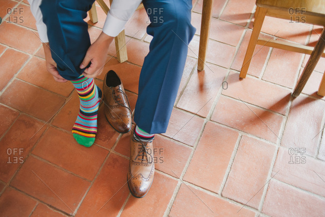 Man dresses in striped socks