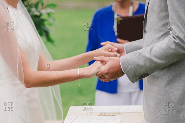 Wedding couple making vows