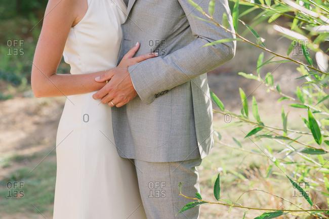 Wedding couple embraces