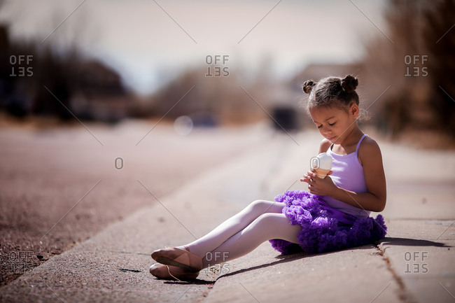 Little ballerina eating ice cream