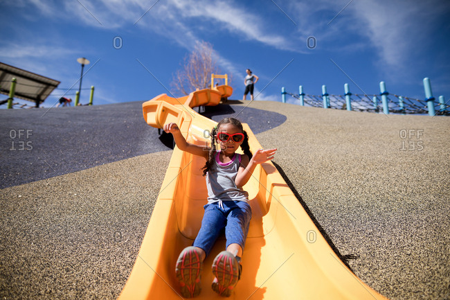 Girl slides at playground