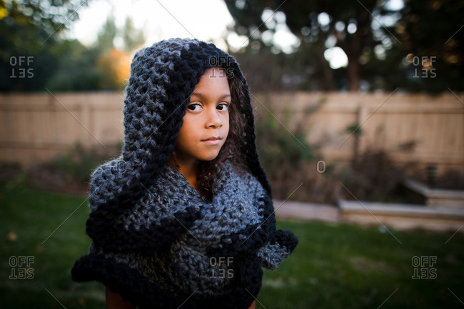 Little girl in knit scarf