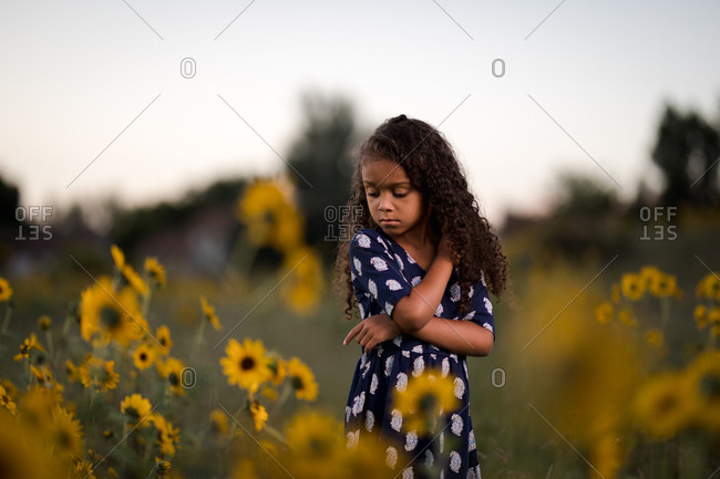 Girl in field of wildflowers