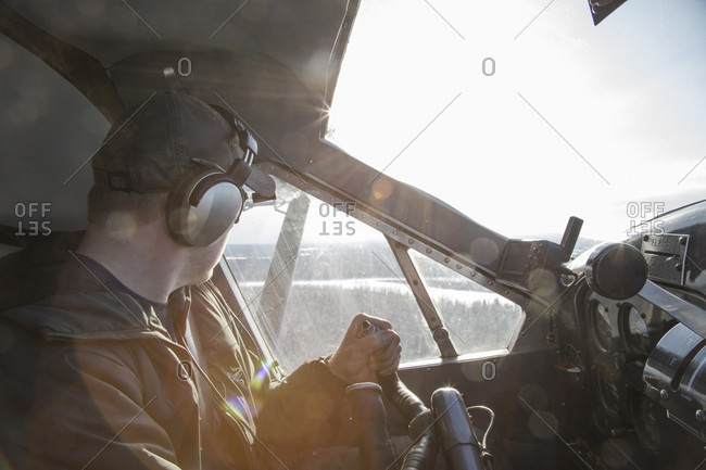 February 19, 2017: A bush pilot looks out his window while flying through the Alaskan wilderness.