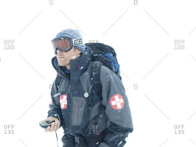 April 28, 2009: A Norwegian mountain guide is navigating in a white out snow storm with a handheld GPS device.