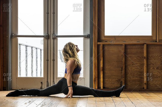 April 15, 2015: Professional Snowboarder and 2014 Olympic Gold Medalist, Jamie Anderson does yoga on a rainy down day in Haines, Alaska.