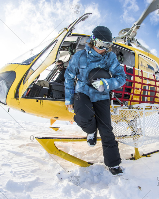 April 17, 2015: Professional Snowboarder Robin Van Gyn, gets out of a helicopter to snowboard a line while on a trip to Haines, Alaska.
