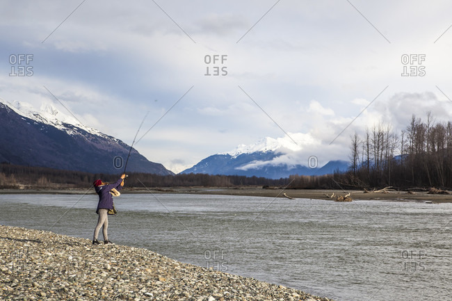 April 20, 2015: Professional Snowboarder Helen Schettini, fishes on the Chilkat River on a down day from snowboarding while on a trip to Haines, Alaska.