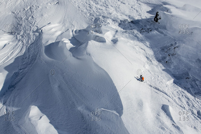 April 21, 2015: Professional Snowboarder Robin Van Gyn, rides fresh powder on a sunny day while snowboarding in Haines, Alaska.