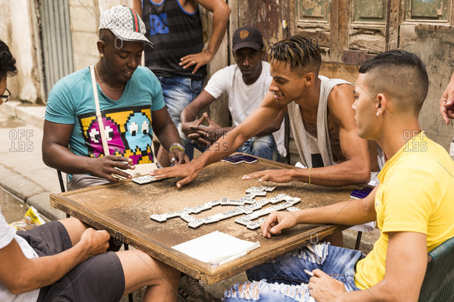 February 16, 2017: A group of men play dominos in the street of Havana, Cuba
