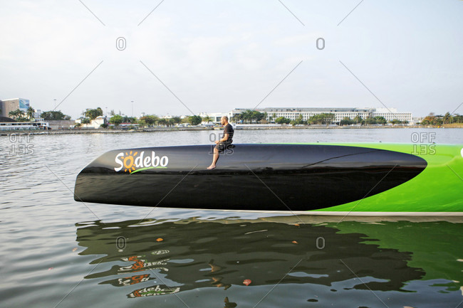 July 29, 2015: Thomas Coville and the Ultime Class 100' VPLP designed trimaran Sodebo in Rio de Janeiro, Brazil. Thomas Coville (FRA) and his 31m maxi trimaran Sodebo Ultim? has successfully broken the solo round the world record, completing the 28400 nm route in 49 days 3 hours 7 minutes and 38 seconds.