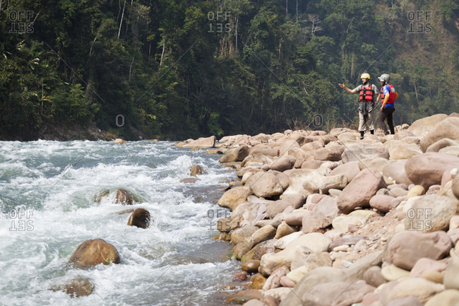 October 23, 2017: Robert Hahn (left) and Mung discuss possible descent routes at a steep rapid on the Nam Ou River, Laos.