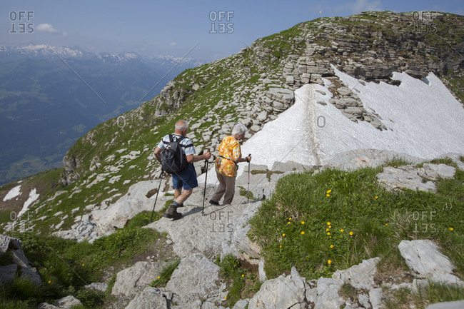 July 14, 2013: An unidentified couple hiking in the Toggenburg region of the Swiss Alps far above Lake Wallen.