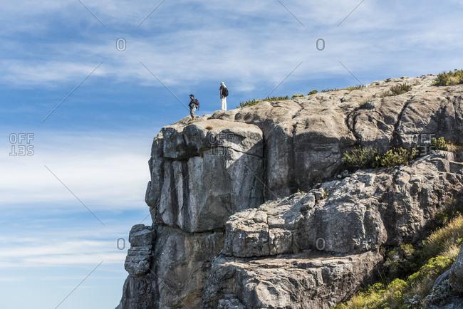 Hikers at summit of Altar Rock, Itatiaia National Park, Rio de Janeiro state, Brazil