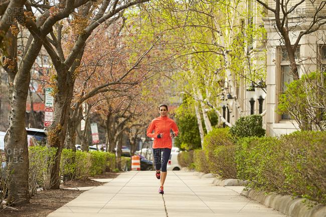 Woman running in Boston, Massachusetts, USA