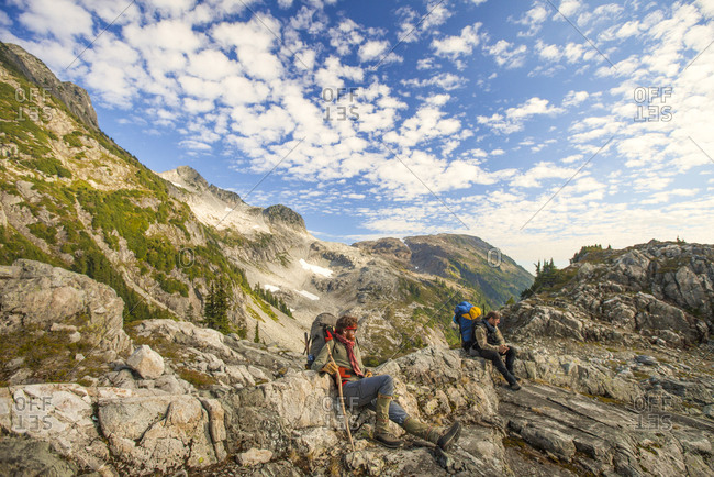 Two mountaineers rest during a hike in the mountains, Garibaldi Provincial Park