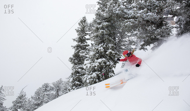 View of woman skiing in Westward Ho at Alta Ski Area, Utah, USA
