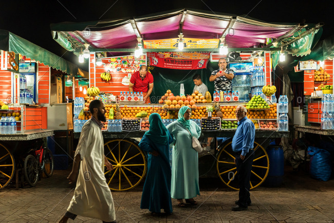 Marrakesh, Morocco - September 28, 2017: Vendor selling juices at Jemaa el-Fnaa