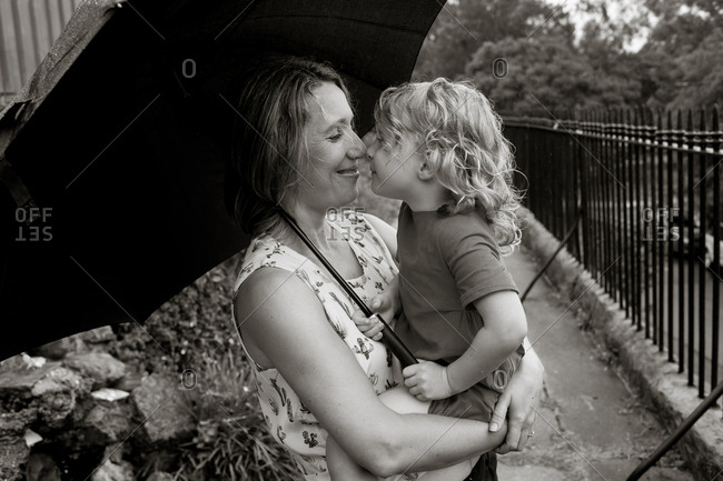 Mother holding toddler girl in black and white