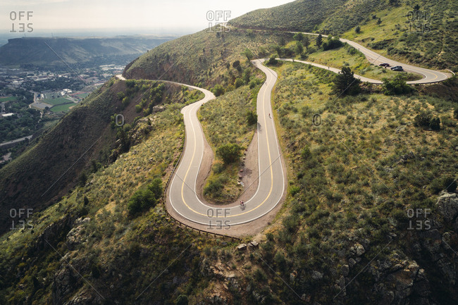 Golden, Colorado - August 9, 2017: Cycling on a curvy mountain road from an aerial perspective