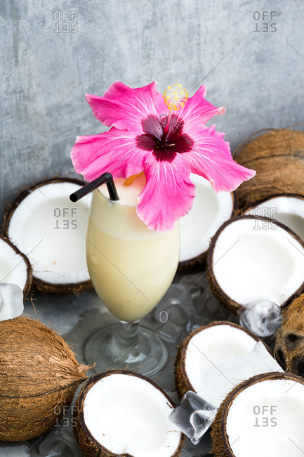 Beautiful cocktail surrounded by coconuts