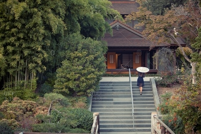 Woman walking up stairs in the Huntington�s Japanese Garden in San Marino, California