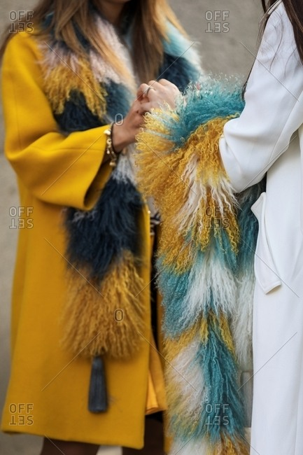 Paris, France - October 2, 2017: Two women wearing furry scarves