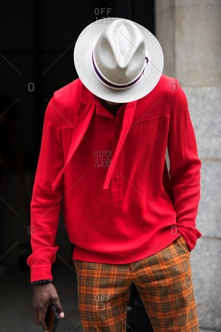 New York City, New York - October 2, 2017: Man in red shirt and tan hat during New York Fashion week