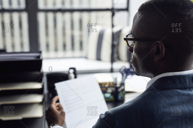 High angle view of businessman studying documents in office