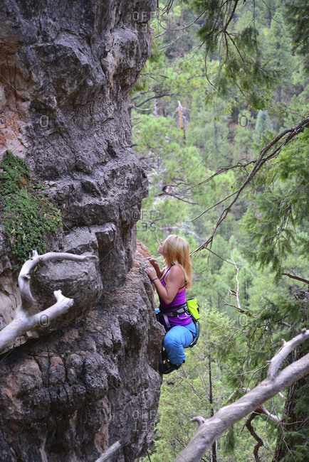High angle view of woman rock climbing at forest