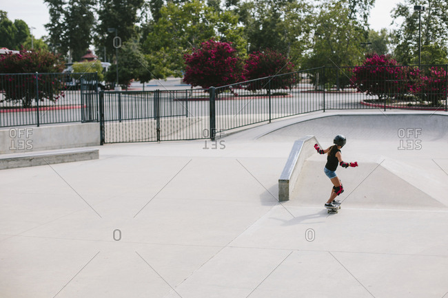High angle view of girl skateboarding at park