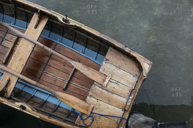 Old wooden boat moored in Lake Prags, Italy